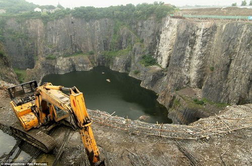 Construction vehicles have begun work in transforming this abandoned quarry into a luxury hotel and will be part of a large-scale theme park, according to senior manager of the Shimao Group Li Xuyang.