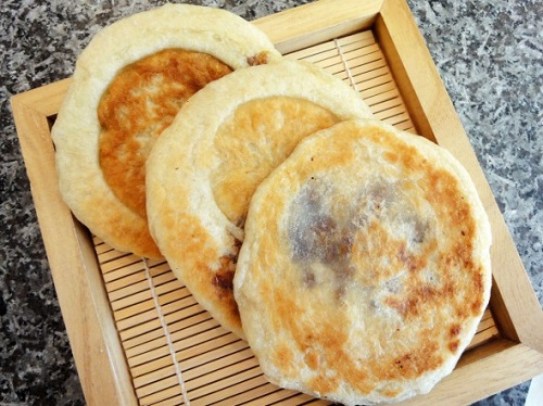 Hot and tasty ssiat hoddeok is a fried pancake with a sweet sunflower seed filling